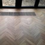 visgraat parket houten rooster convectorput